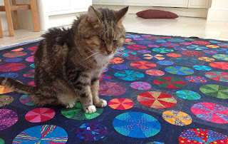 Sparky the cat on the Pies and Tarts Quilt