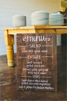 Using large wooden boards to create food labels at the end of the buffet