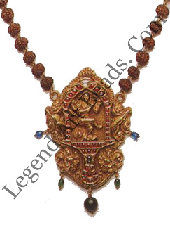 RUDRAKSHA MALAI (necklace) South India 19th century Courtesy Musee Barbier-Mueller, Geneva 12504-1091 A pendant with an image of Natraia, enclosed within a shrine of cabuchon rubies and diamonds. A simpler variation of the magnificent gowrishankaram (plate 127) it functions as a portable shrine.