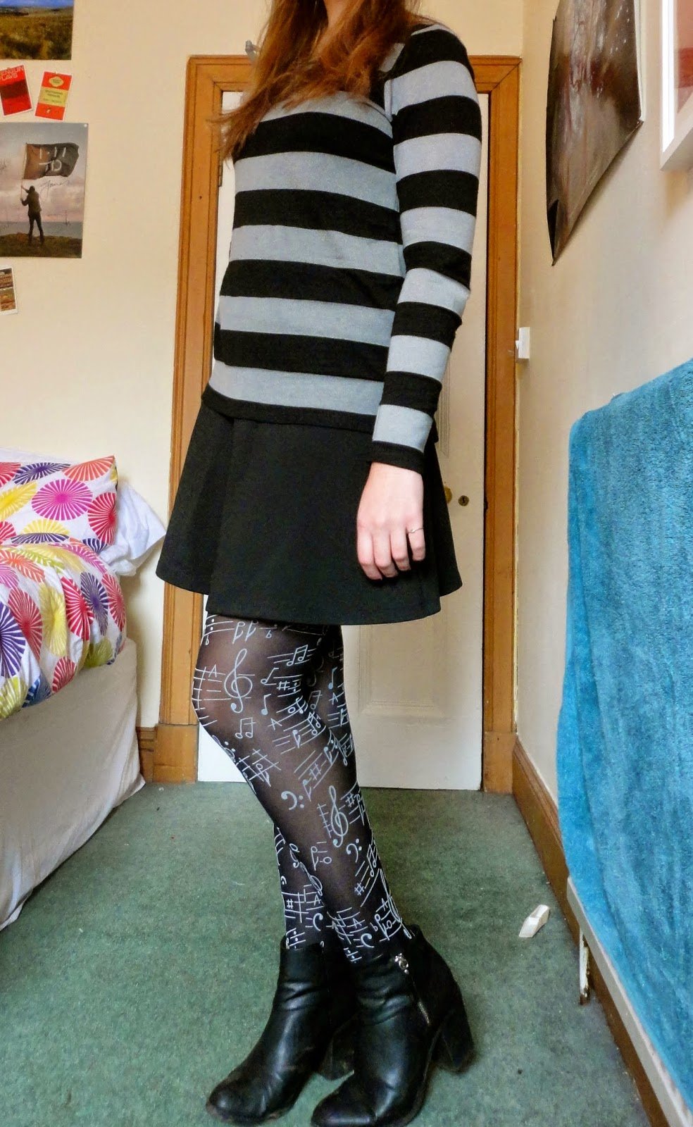 outfit of striped jumper, black skirt and musical tights
