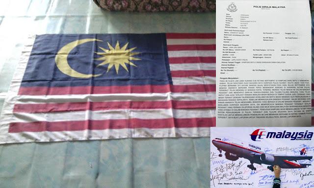 Sehelai Bendera Malaysia & Tiga Keping Gambar Pulau Telah Diserahkan Kepada Polis
