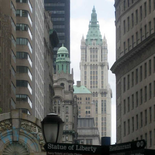 Up Broadway - From the northeast corner of Battery Park, to the Trinity and Woolworth buildings.