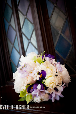 Lavendar, cream and purple bridal bouquet in window
