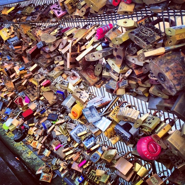 Love locks attached to Passerelle Leopold-Sedar-Senghor in Paris