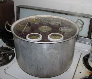 jars of food being processed by hot water bath