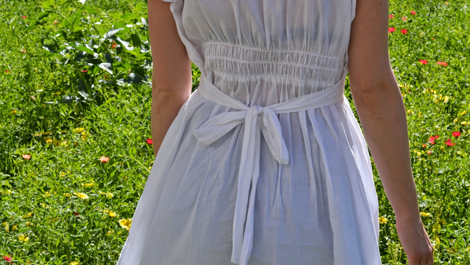 Elastic back of white dress