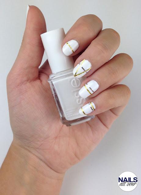 Used: Essence Studio Nails 24/7 Nail Base -  Essie Blanc -  Seche Vite Dry Fast Top Coat -  Striping Tapes