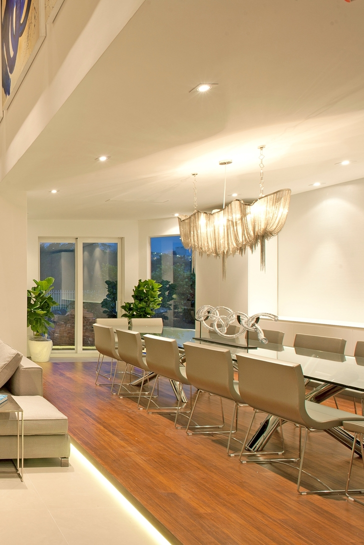 Dining room in Modern home by DKOR Interiors