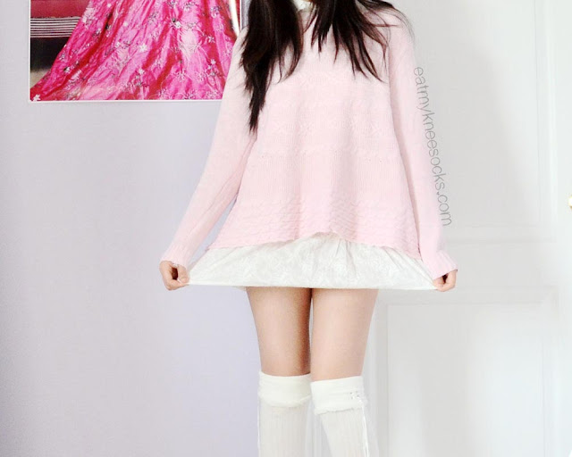 SheIn's coordinated two-piece set includes a pink sweater and white ruffled vest that go together perfectly for a cute ulzzang look.