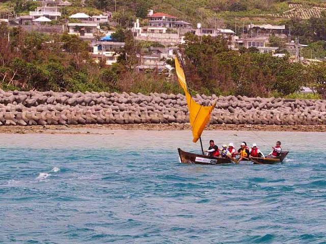 sailing sabani boat hoisting sail
