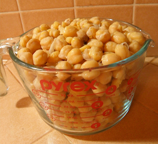 Four Cup Measure Filled to Six Cups with Garbanzos