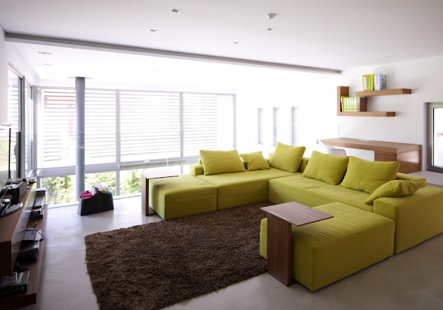 Green sofa in the second living room