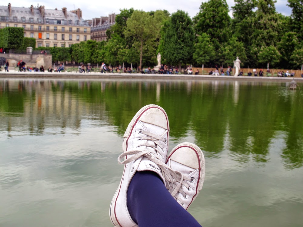 white leather Converse Chuck Taylor trainers in the Jardins des Tuileries, Paris