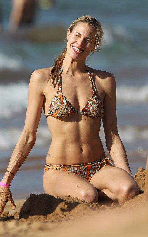 Brooke Burns flaunts her bikini body