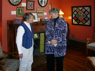 Robin Atkins with a visitor at the opening of Beadlust exhibition