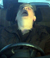 Man asleep in his car