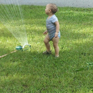 Our baby's first time playing in the sprinkler water spraying everywhere