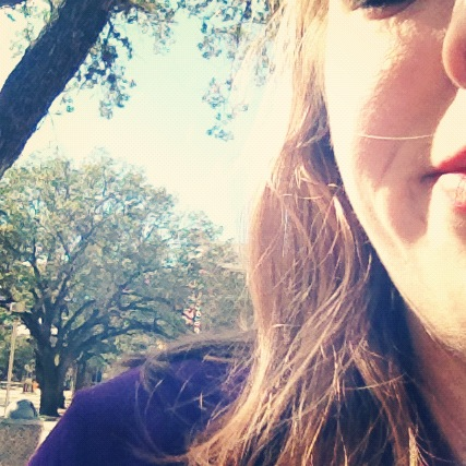A picture of me smiling in the sunshine outside on a beautiful day