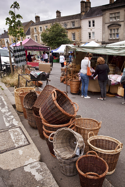 Market day at Chipping Norton with hand woven baskets for sale