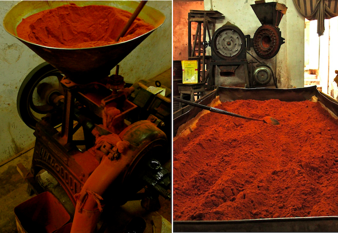 dried red chili grounded into powder by old spice grinding machine, and drying red chili powder