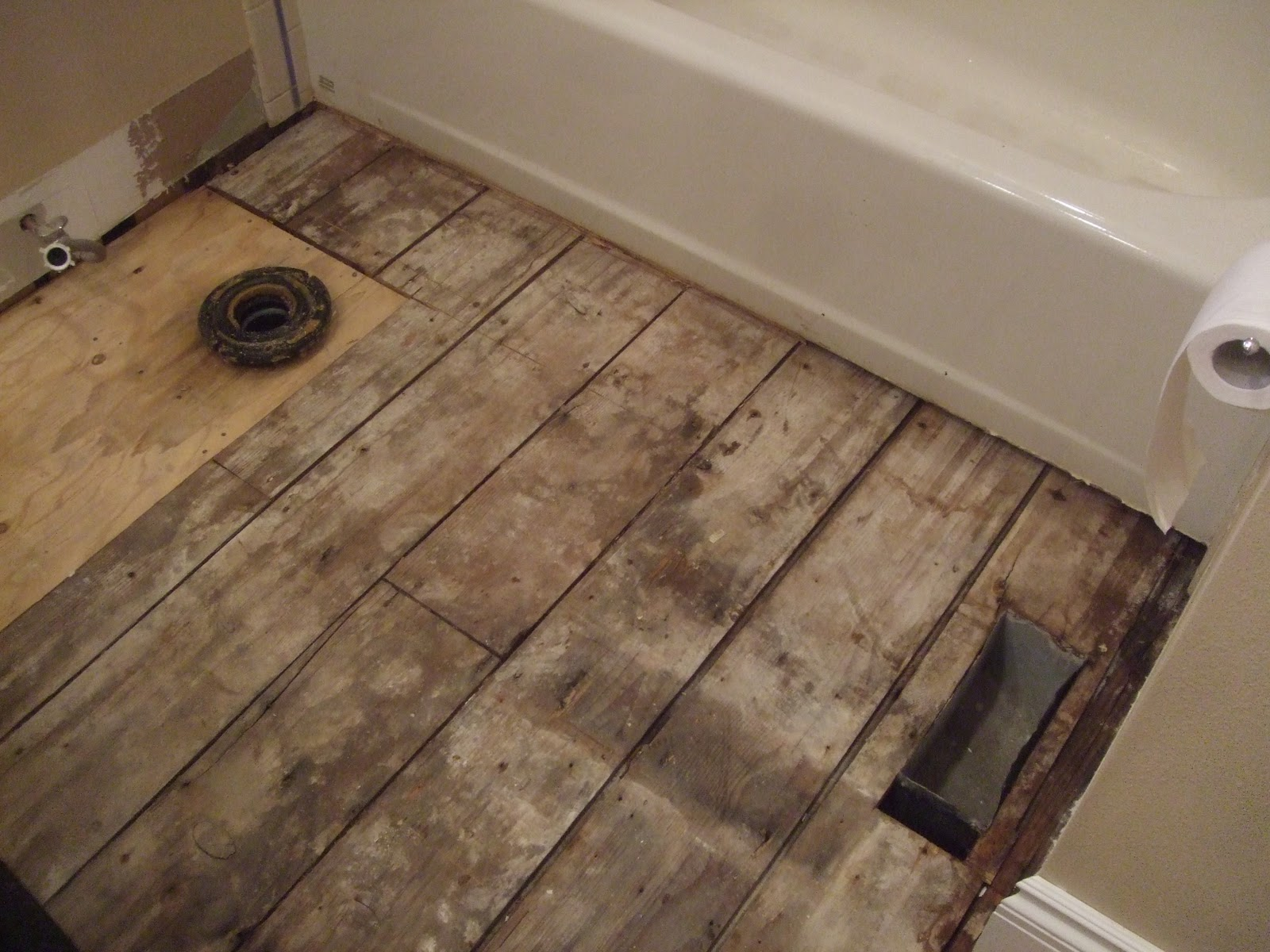 The smiths laying bathroom wood flooring for Replace bathroom subfloor