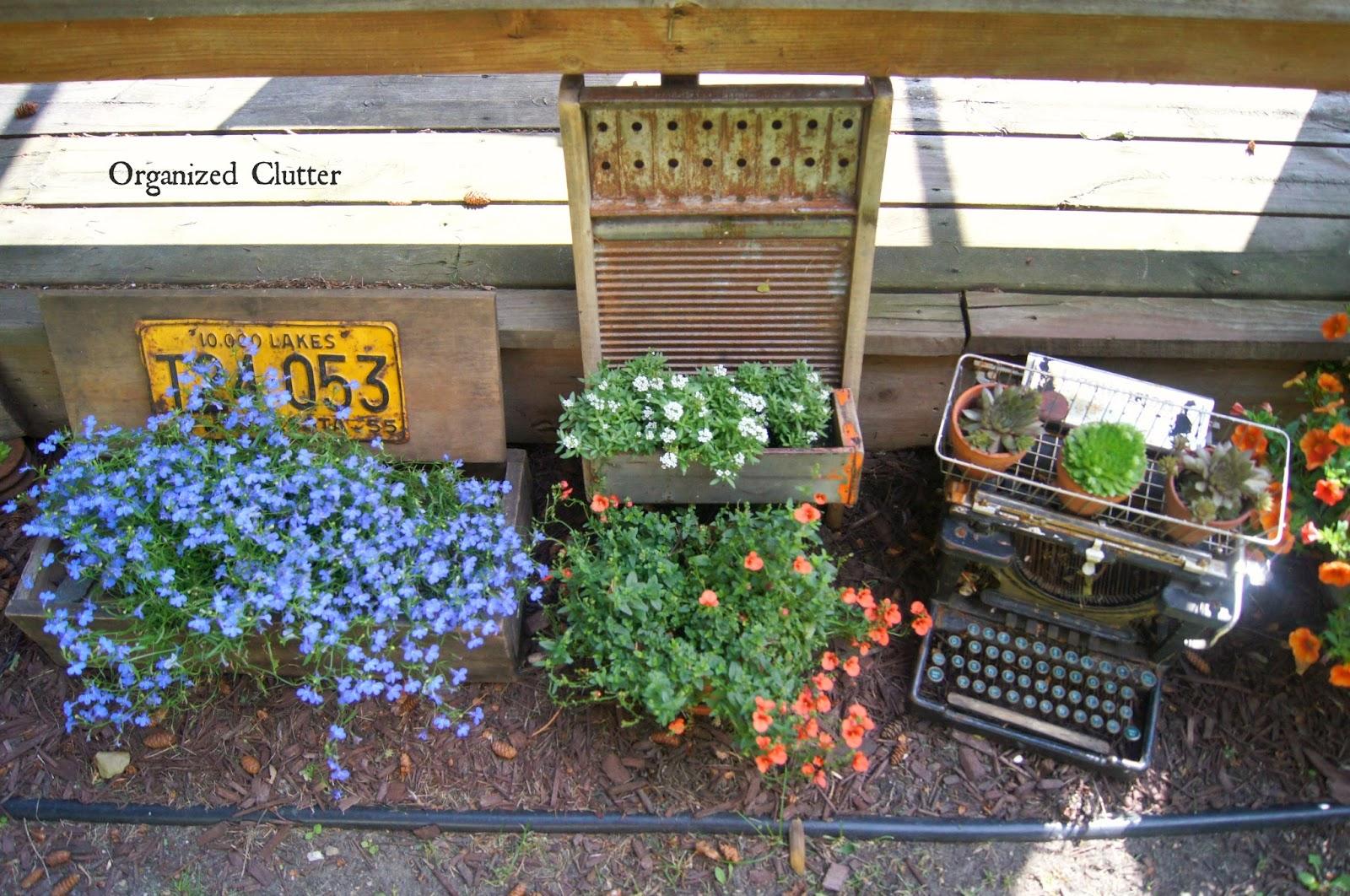 Washboard Planter, Garden Typewriter, & Old Crate Planter www.organizedclutterqueen.blogspot.com