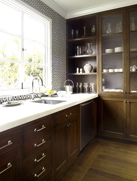 Kitchen with black and white Moroccan tiles, wood cabinets and white marble counter tops by House of Fifty