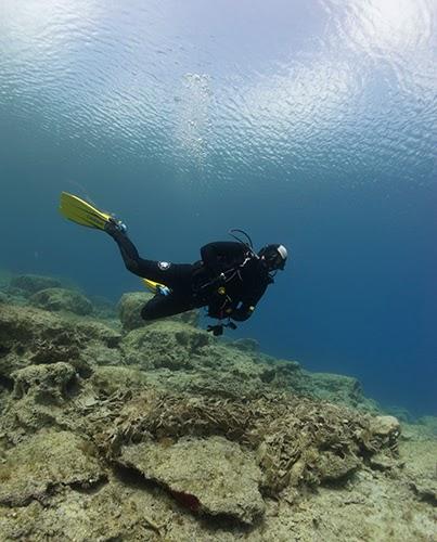 scuba diver underwater taking a deep breath