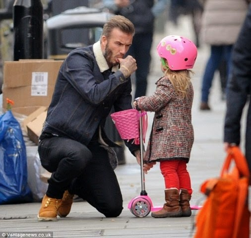Photos: David Beckham looks on proudly as his daughter scoots through London