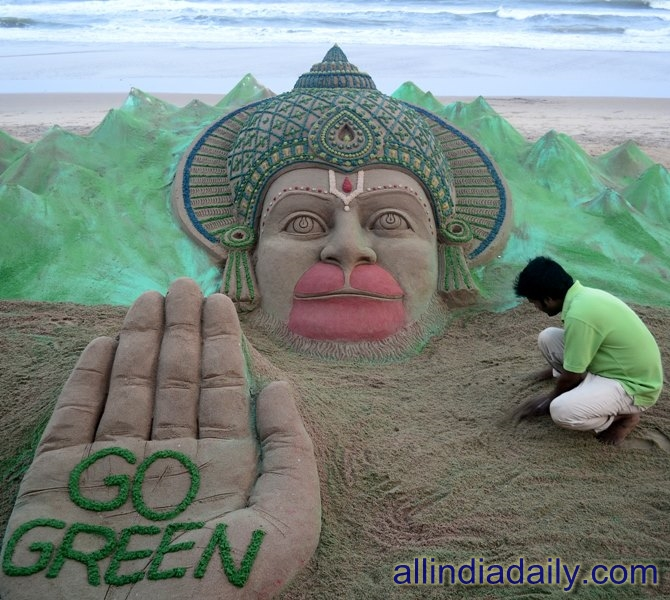 "On the eve of Hanuman jayanti Sudarsan Pattnaik have created a sand sculpture of Lord Hanuman with a message ""Go Green"" at Puri beach, Odisha"