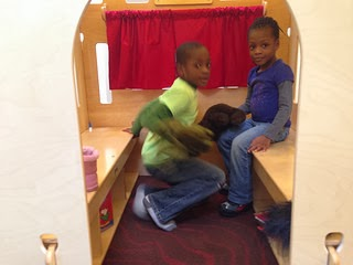 two children inside the puppet theater at Gaithersburg Librar