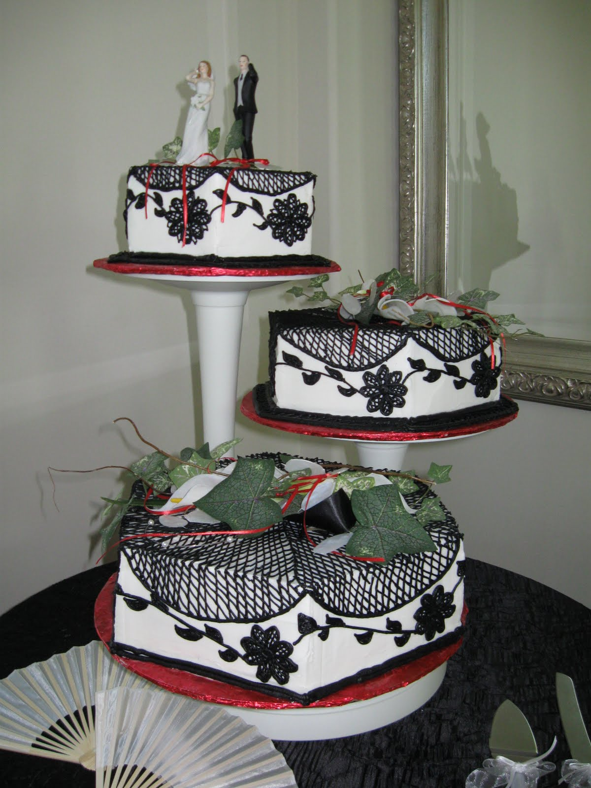 ChubbyHubbyCakes Black white and red wedding cake