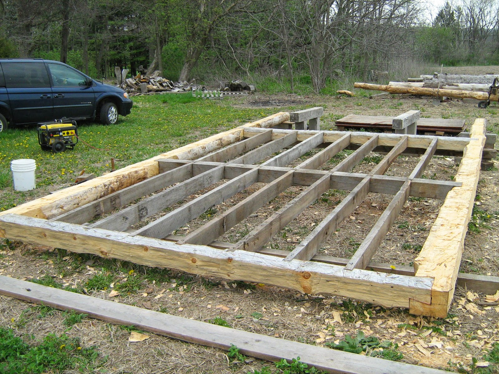 Bridges to the future log cabin foundation framed up for How to build a pier foundation