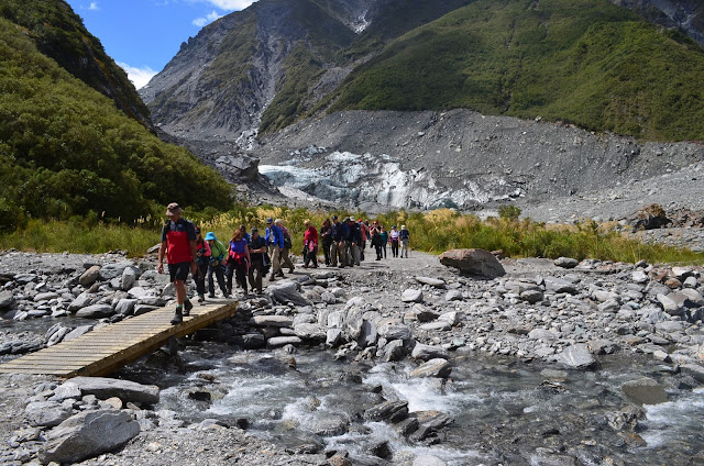 Hikers on their way back from Fox Glacier, New Zealand