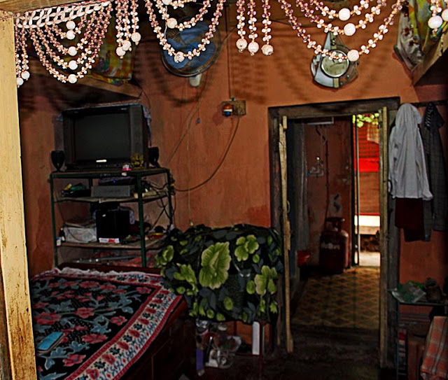 Stock pictures interiors of rural homes in india Lower middle class home interior design