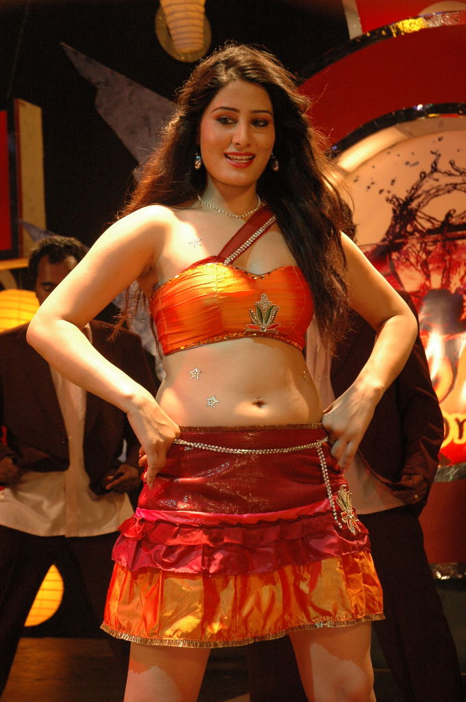 Telugu actress Ajju in Spicy Orange Choli and Mini Skirt for an Item Song