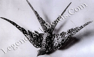 A swallow corsage ornament, set with diamonds and Montana sapphires to represent the blue sheen of the wings. This piece was shown in the 1901 Pan-American Exposition in Buffalo.