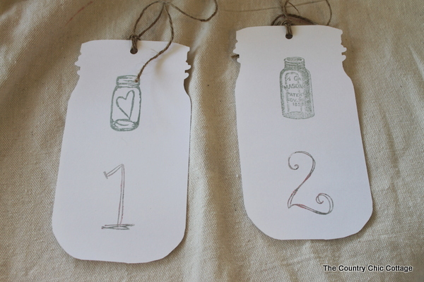 mason jar tags for wedding reception table numbers