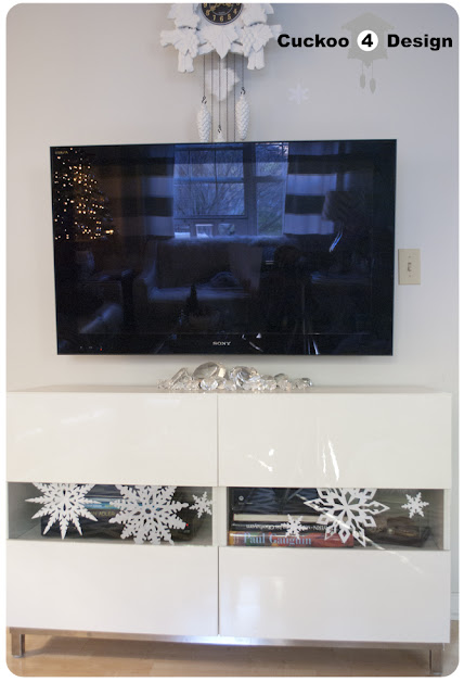 white paper snowflakes on Ikea Besta TV Stand