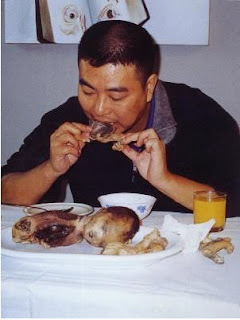 SHOCKING:Chinese Man Eating Roasted Baby