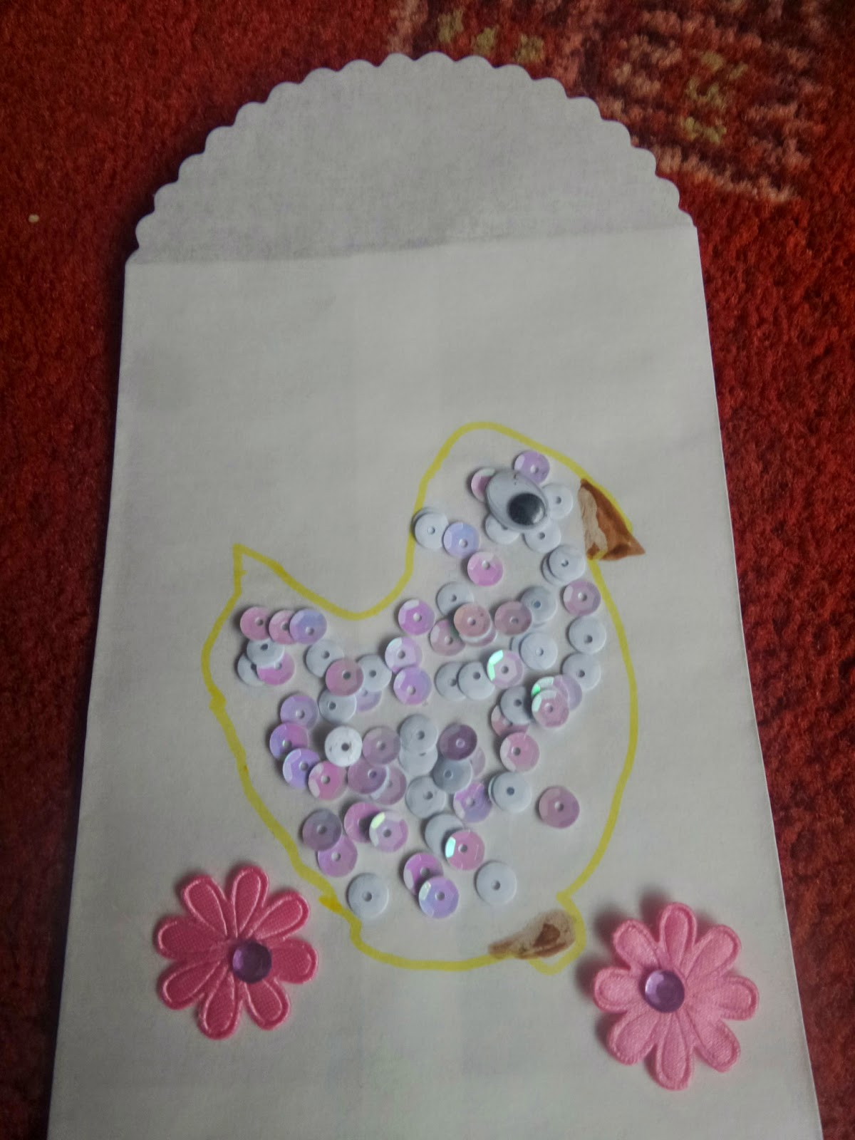A sequined Chick on an envelope