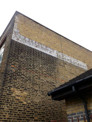 station ghost sign stoke newington