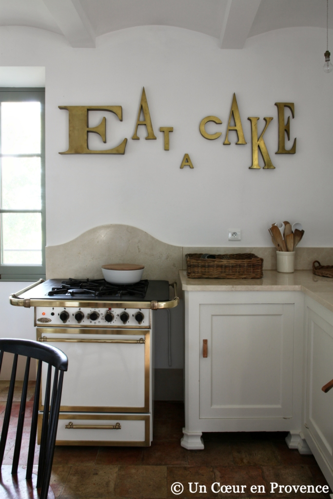 In a kitchen, Godin gaz cooker and former brass letters from a sign into the decoration like a decoration