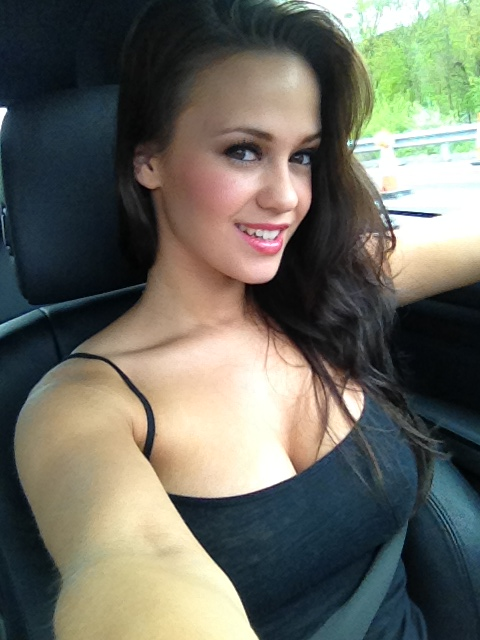 hot babe with big tits Emma K in the car photo