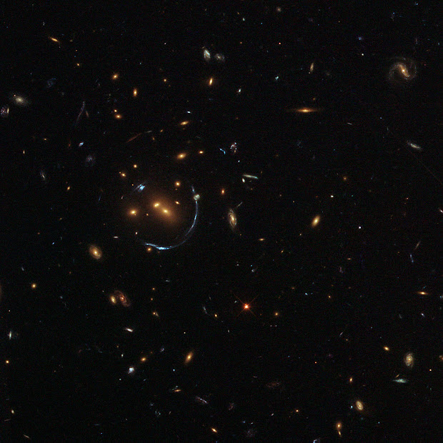 Hubble snaps an Arc sculpted by Gravity around LRG-4-606!