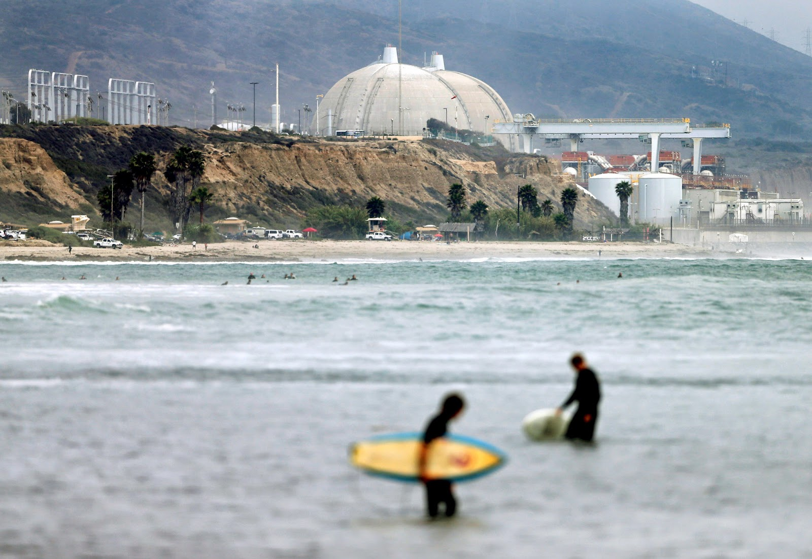 The troubled San Onofre nuclear plant in California is in the initial stages of preparation to be decommissioned after being closed in 2013.  It was one of several reactors across the country that are planned to close. (Credit: Gregory Bull/Associated Press) Click to enlarge.