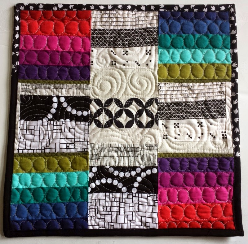 http://quiltyhabit.blogspot.com/2015/03/cross-of-rainbows-mini-quilt.html