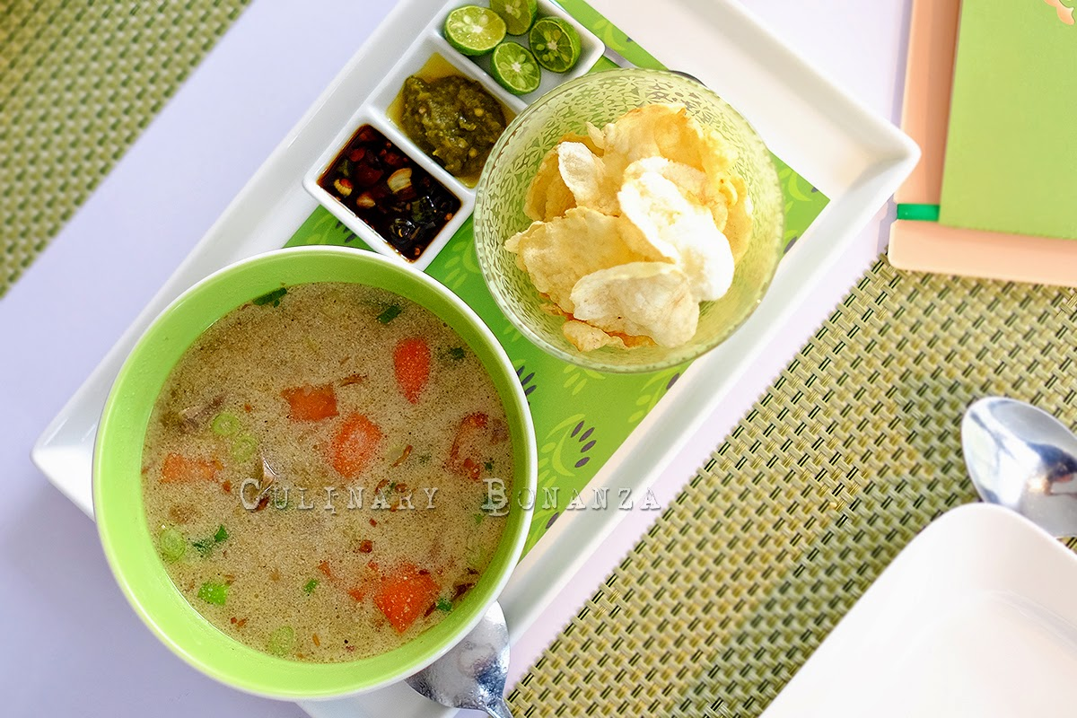 Soto Betawi - Beef, vegetables and potato soup in milky broth, served with melinjo crackers and green chili.