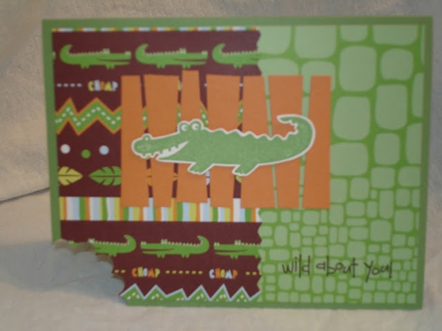 "Green card with scalloped circle punched out of the corner to look like an alligator chomp. Alligator print and jungle-themed papers, an alligator focal image and the sentiment ""wild about you.""."