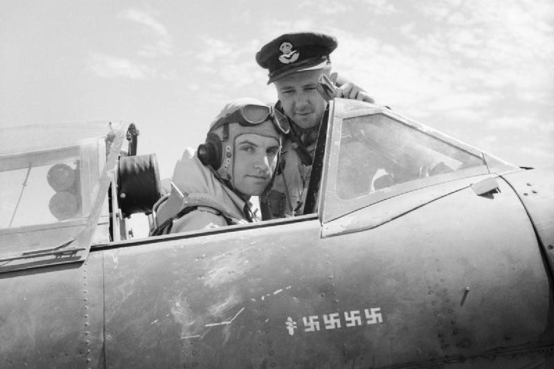 An RAF pilot sitting in the cockpit of a Supermarine Spitfire